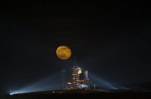 space shuttle full moon night
