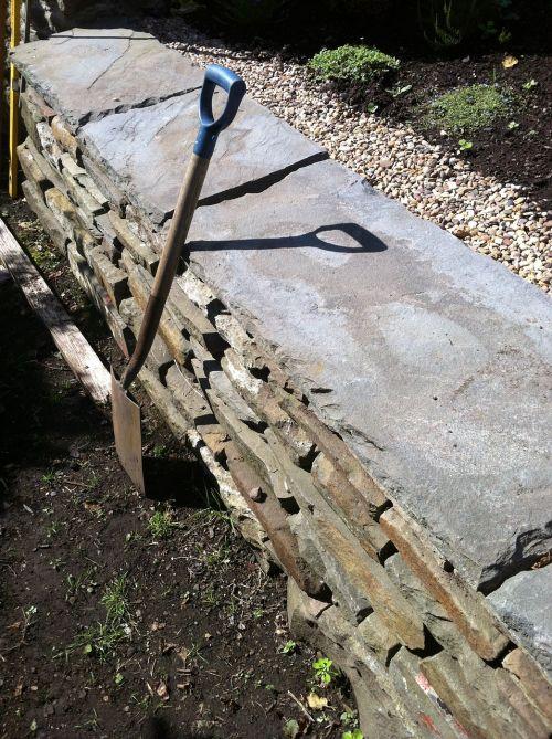 spade garden wall