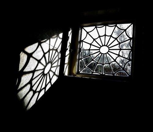 spider web window  leaded window  vintage window