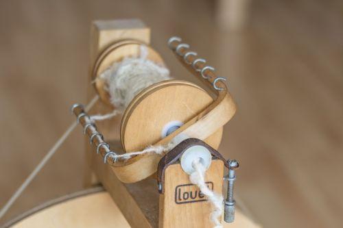 spinning wheel spiders wool