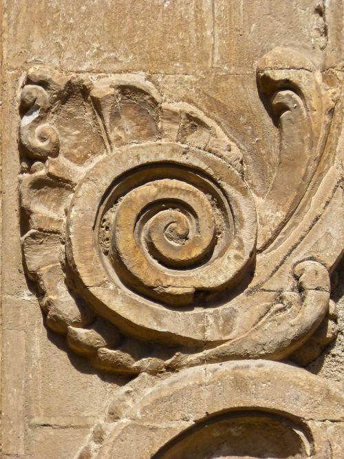 spiral snail carved stone