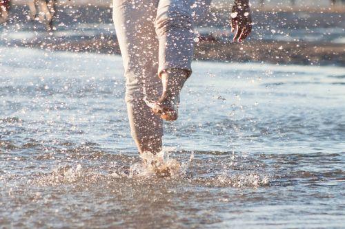 splashing feet ocean