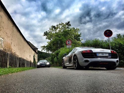 sports car road clouds