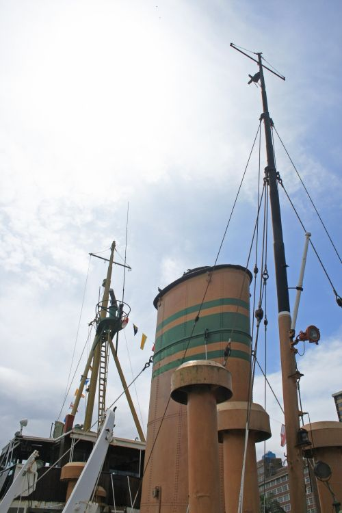 Stack & Mast Of Old Tug Against Sky