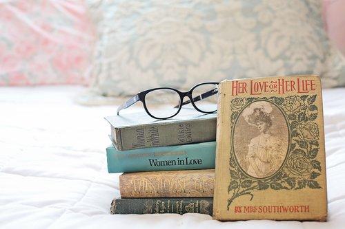 stack of books  vintage books  women's novels