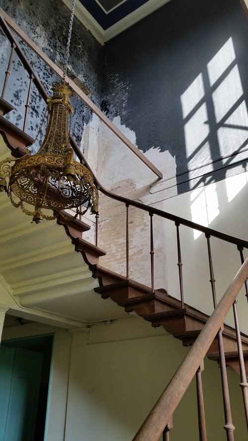 staircase  chandelier  rust
