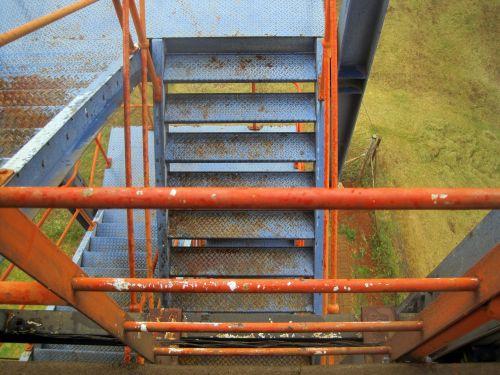 Stairs And Orange Railing