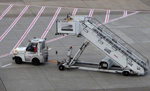 stairs vehicle  tarmac  airport