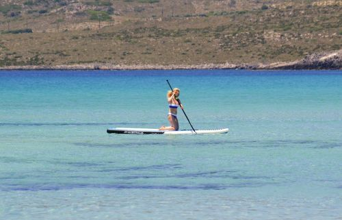 stand up paddle board water sports woman