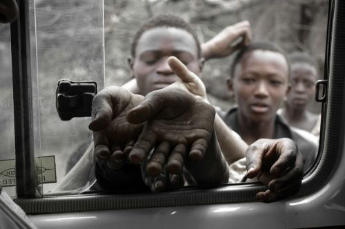 starving children waiting in addition to the road somewhere in tanzania