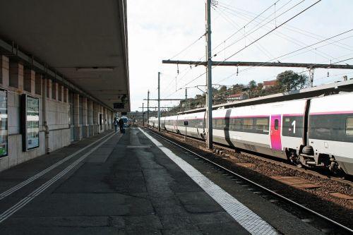 station platform people train and platform