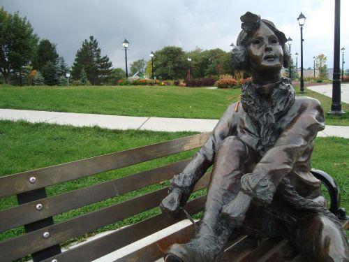 statue girl tying shoelaces