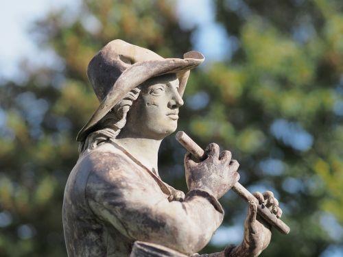 statue shepherd flute