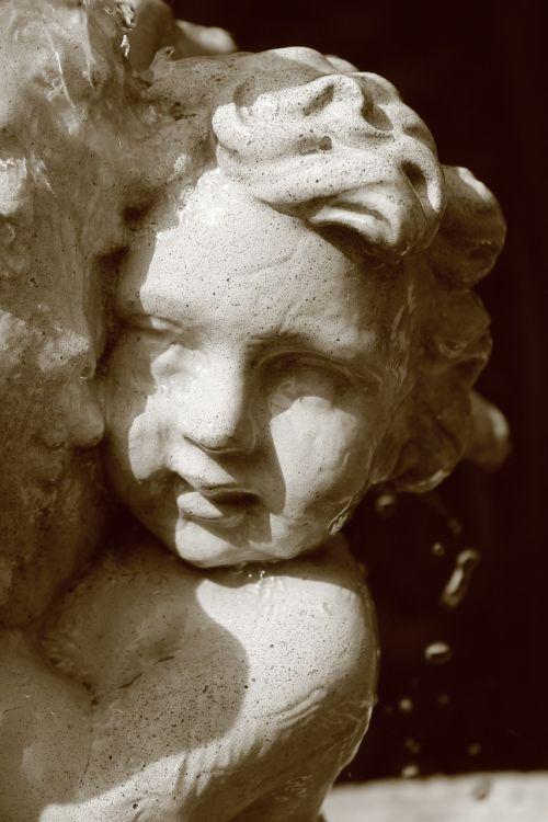 statue cherub water