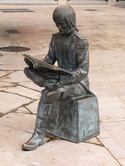 statue reading man