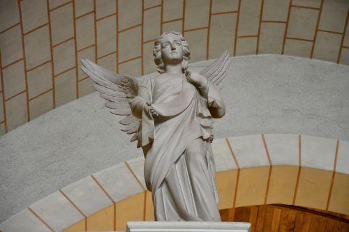 statue angel carved stones church tinteniac brittany