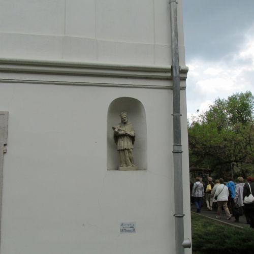 Statue Of A Priest In The Wall