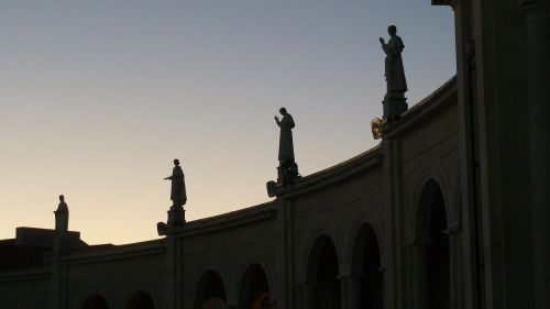 statues silhouette building