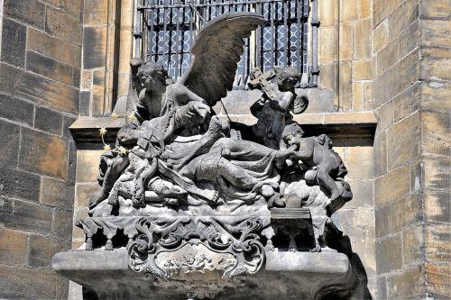 statues prague historically