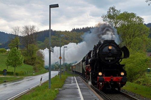 steam locomotive  railway station  nature