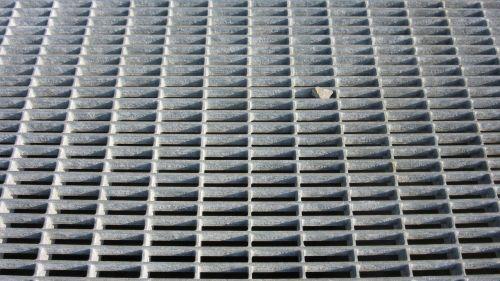 steel grid pebble shadow