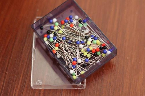 stilettos in a box  needles  sewing