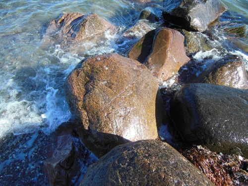 stone breakwater detail beach