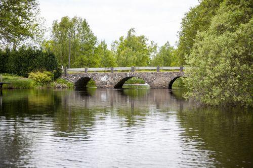 stone bridge water forest