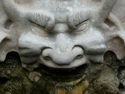 stone figure devil grim