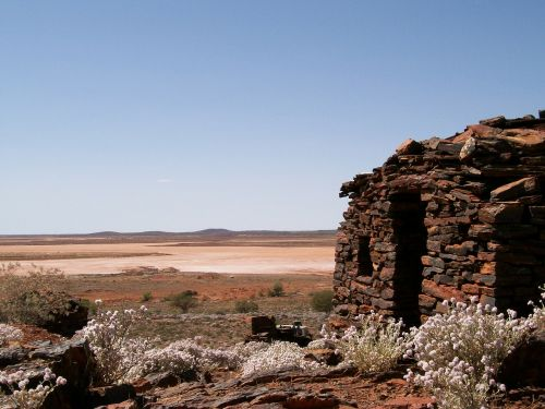 stone house desert heat