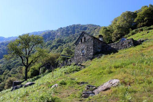 stone house alpine switzerland