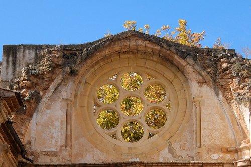 stone monastery  rosette  autumn