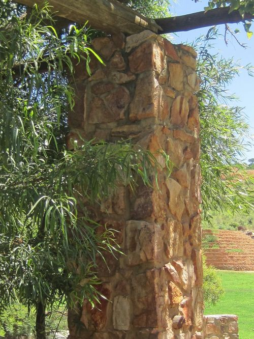 Stone Pillar And Tree