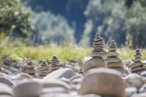 stone sculpture cairn water