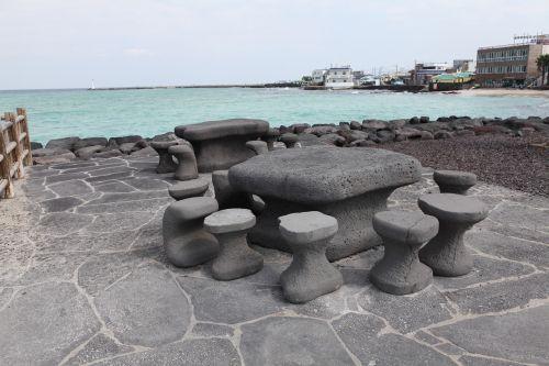 stone statue emerald sea jeju island