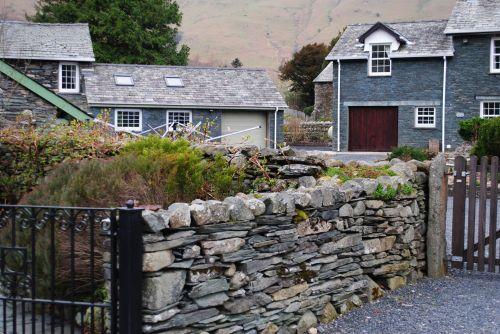Stone Wall And Farmhouse