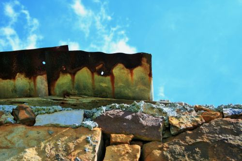 Stone Wall And Rusted Roof