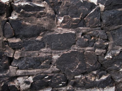 Stone Wall Blackened By Fire