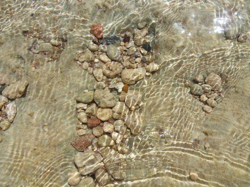 stones stones under water sea