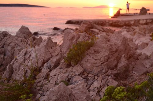 stones sunrise sea