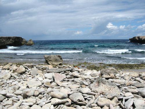 stones sea clouds