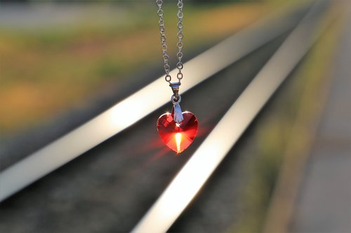stop youth suicide  red heart medallion on railway  for all kids and teens