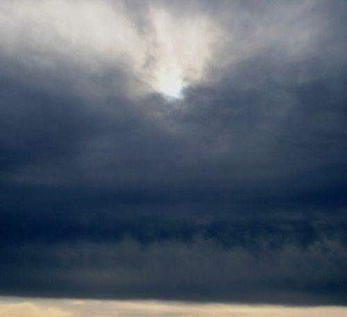 Storm Sky With Sun Penetrating