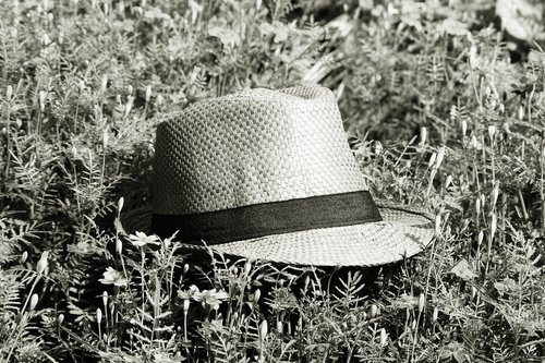 straw hat  summer meadow  black and white photography