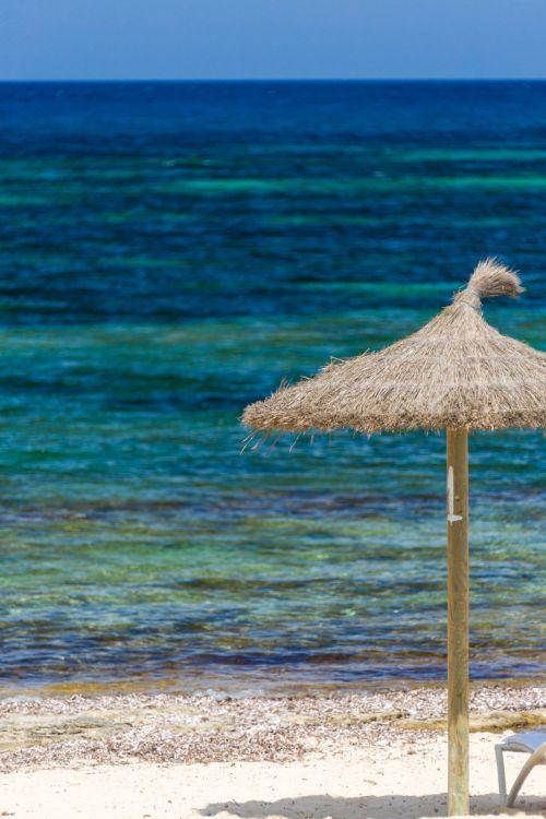 Straw Umbrella On The Beach
