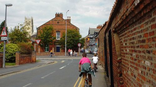 street,village,england,yorkshire,hedon,sidewalk,bicycles,boys,bicycle,ride,minster,houses,house,cottage,building,clouds