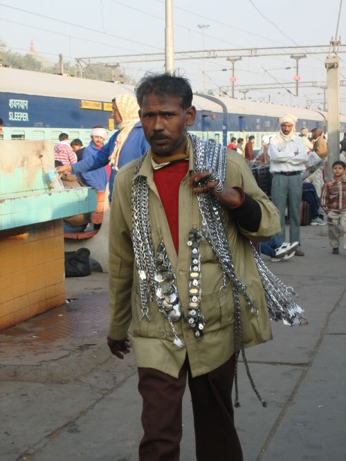 street,seller,street vendor,railway station,sale,vendor,marketplace