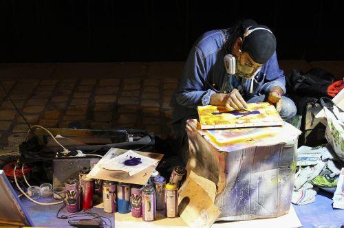 street artist sidewalk painter seated