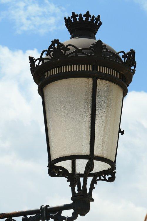 street lamp  sky  clouds