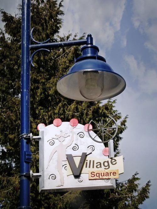 street lighting fixture blue sign